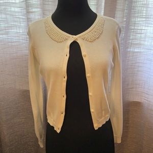 White cardigan with pearl design collar